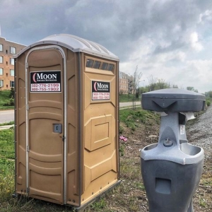 A portable restroom and hand washing station from Moon Portable Restrooms, part of a press release